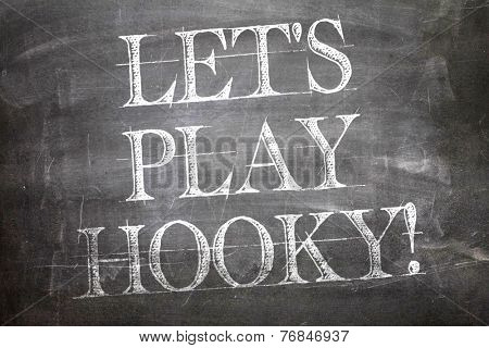 Lets Play Hooky written on blackboard