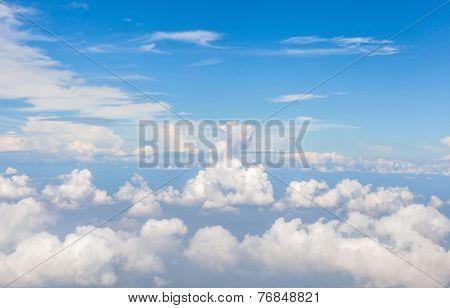 Beautiful Fluffy White Cumulus Clouds In Sunny Blue Sky.