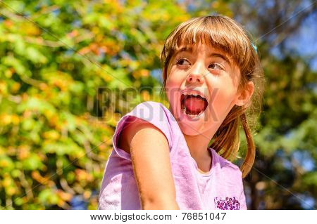Seven year old girl  sitting on the wall