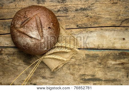 Fresh Rye Bread With Ears On Wooden Table