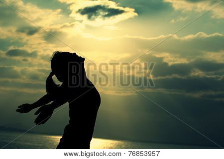 woman open arms under the sunrise at seaside woman open arms under the sunrise at seaside
