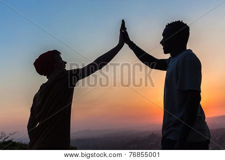 Friends High Five Hands Sunset