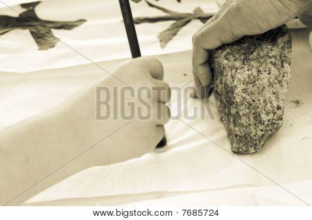 child drawing hieroglyph