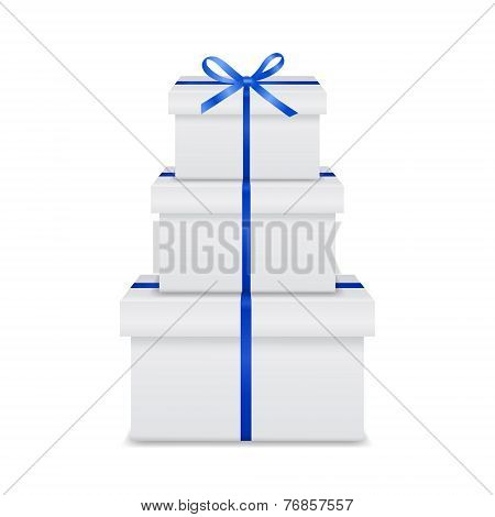 Stack Of White Gift Boxes With Blue Ribbon And Bow