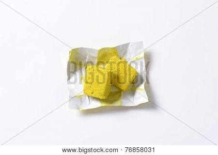 two bouillon cube in the paper wrapper