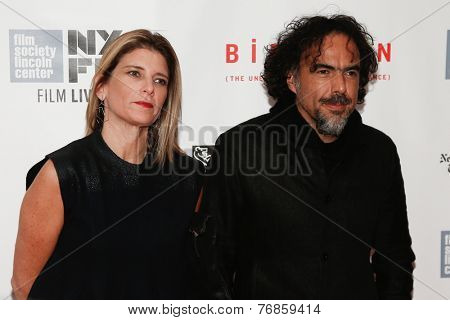 NEW YORK-OCT 11: Director Alejandro Inarritu (R) & Maria Eladia Hagerman at 'Birdman Or The Unexpected Virtue Of Ignorance' premiere at the New York Film Festival on October 11, 2014 in New York City.