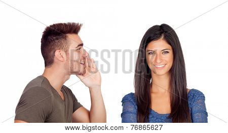 Boyfriend talking a secret his girlfriend isolated on a white background
