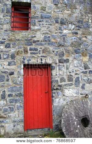 Old stone building with red door