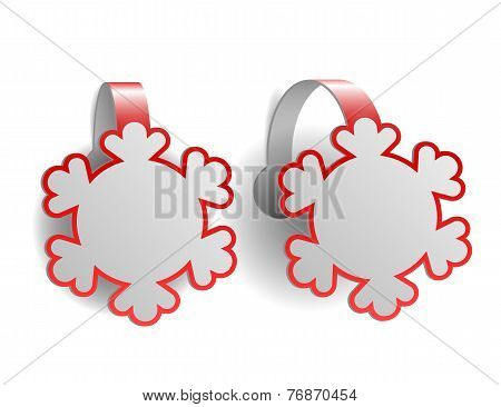 Red advertising wobblers shaped like snowflakes