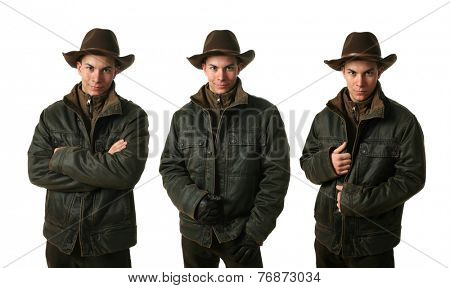 Three young men wearing winter clothes isolated on white