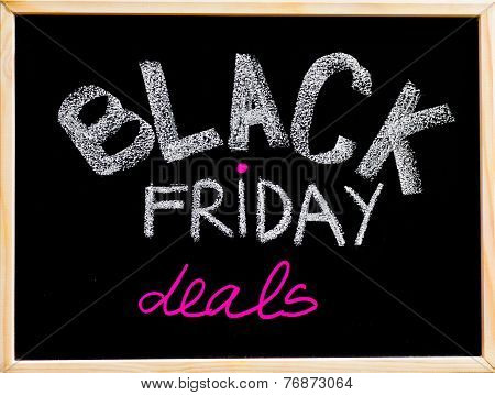 Black Friday Deals Advertisement Handwritten With Chalk On Wooden Frame Blackboard