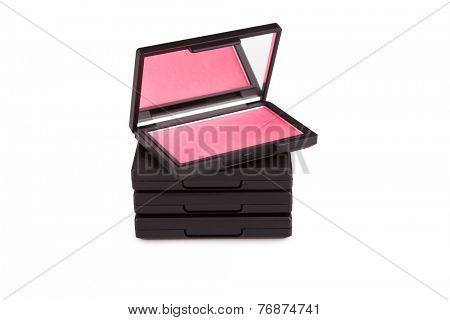Pink blush on a pile of blush boxes isolated on white