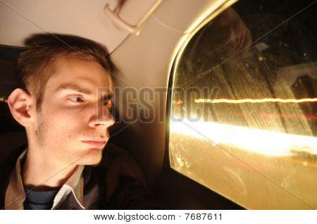 Young Man Looking Out Car Window