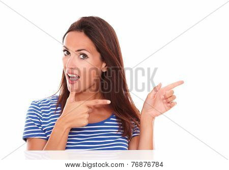 Charming Woman Pointing To Her Left