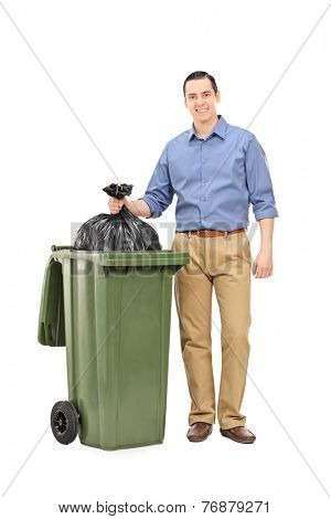 Full length portrait of a young man throwing out the garbage isolated on white background