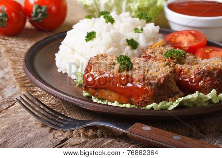 Pieces Of Meatloaf And Rice On A Plate Close-up, Horizontal