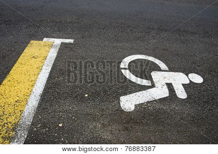 Wheelchair Handicap Sign On Asphalt Road Street Background