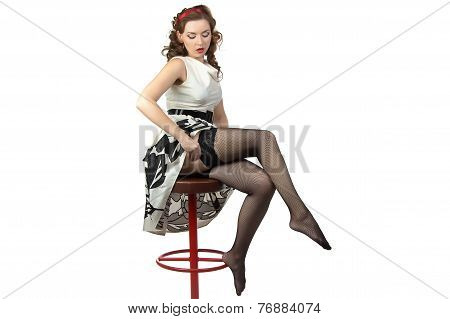 Image of the surprised woman wearing stockings