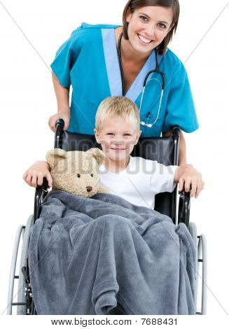Beautiful Female Doctor Carrying Adorable Little Boy In The Wheelchair