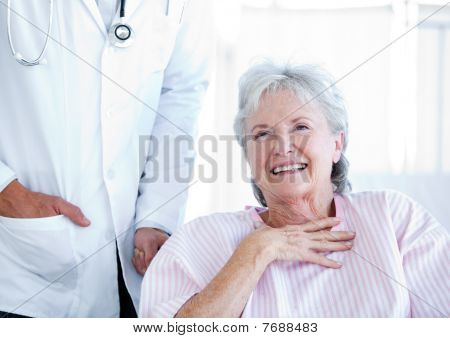 Laughing Senior Woman Sitting On A Wheelchair