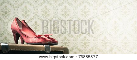Vintage Female Shoes On A Suitcase