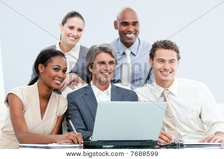 Smiling International Businessteam Working With At The Laptop