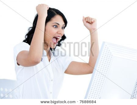 Enthusiastic Businesswoman Punching The Air In Front Of Her Computer