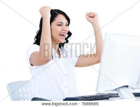 Positive  Businesswoman Punching The Air In Front Of Her Computer