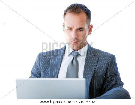 Handsome Businessman Using His Laptop
