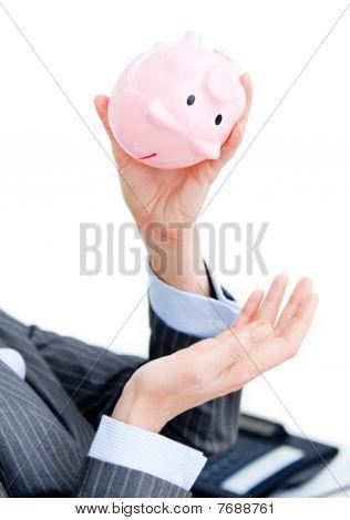 Close-up Of A Businesswoman Holding A Piggy-bank