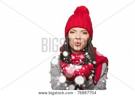 Winter woman blowing snow