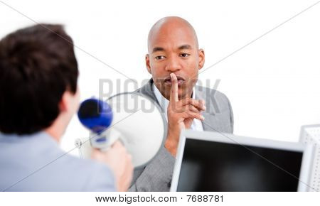 Confident Businessman Asking For Silece While His Colleague Yelling Through A Megaphone