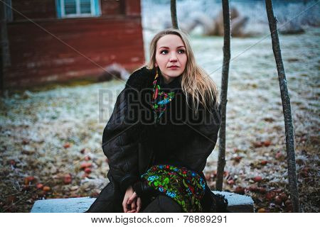 girl sitting on a bench in the vill