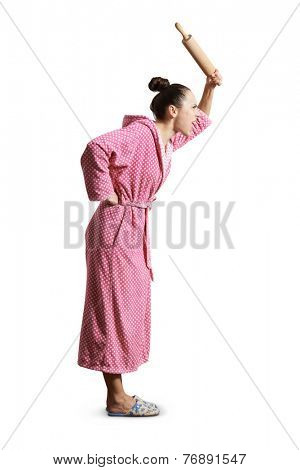 angry housewife in dressing gown holding rolling pin and screaming. isolated on white background