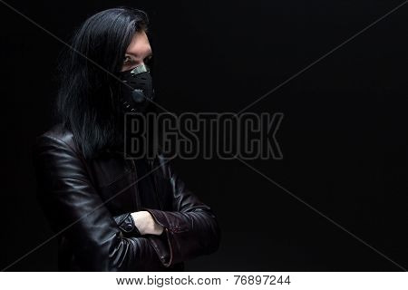 Portrait of the brunet man in mask