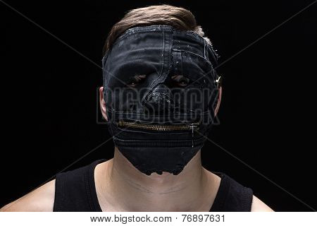 Portrait of the young man in handmade mask