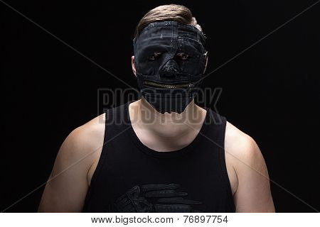Image of the young man in handmade mask