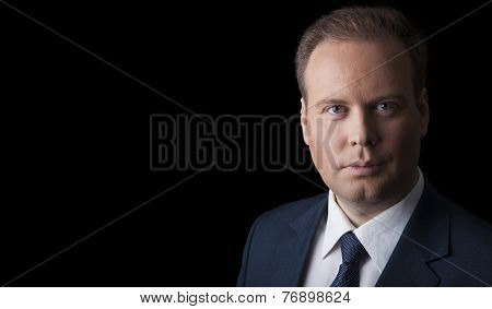 Man In A Suit And Tie On A Black Background