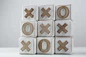 stock photo of tic-tac-toe  - Game of Tic Tac Toe on table - JPG