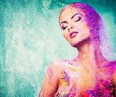 foto of time-piece  - Beautiful young woman with conceptual colourful body art  - JPG