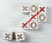 image of tic-tac-toe  - Game of Tic Tac Toe on wooden background - JPG