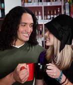 image of native american ethnicity  - Interracial couple together at a coffee house - JPG