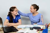 stock photo of praises  - Gracious teacher praises and pats on the head with a good pupil girl - JPG