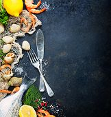 picture of clam  - Delicious fresh fish and seafood on dark vintage background - JPG