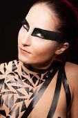 picture of sado-masochism  - Beauty sexy girl in black tape dress studio posed bdsm - JPG