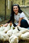 Laughing Woman Feeding Chicken