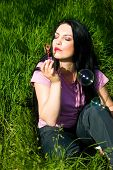 Woman In Green Grass With Soap Bubbles