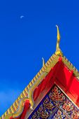 picture of gable-roof  - Gable apex on thai temple roof and blue sky background - JPG