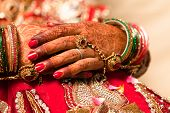 pic of bangles  - Hand detail of indian bride with decorative bangle and gold ring - JPG