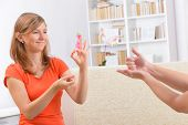 image of deaf  - Smiling deaf woman learning sign language and talking with her teacher - JPG